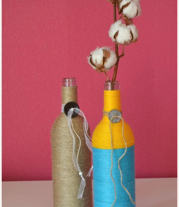 Fest umschlungen… DIY-Vasen aus alten Flaschen