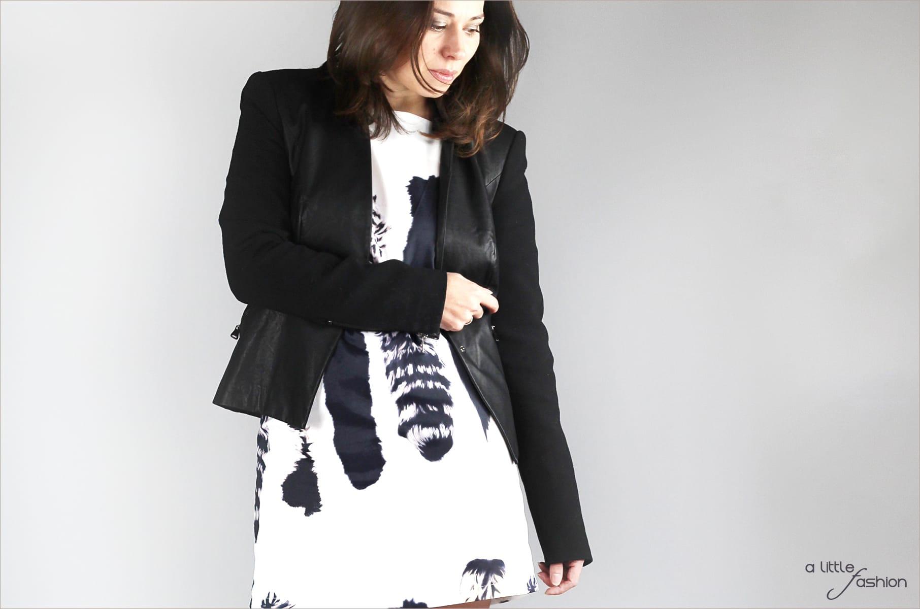 Rock Chic mit rückenfreiem Kleid und Lederjacke
