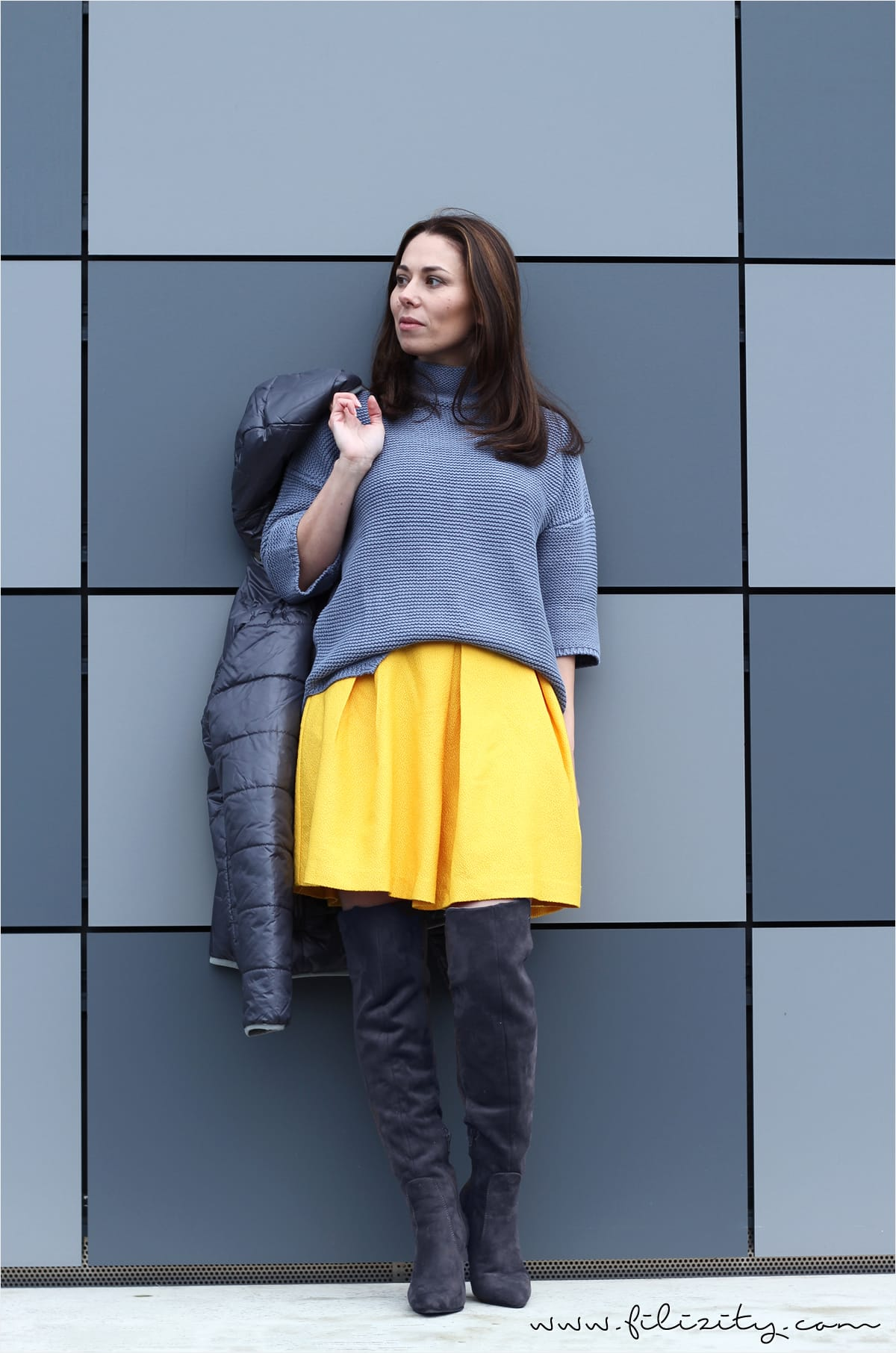 winter look with yellow skirt, overknee boots and knit sweater