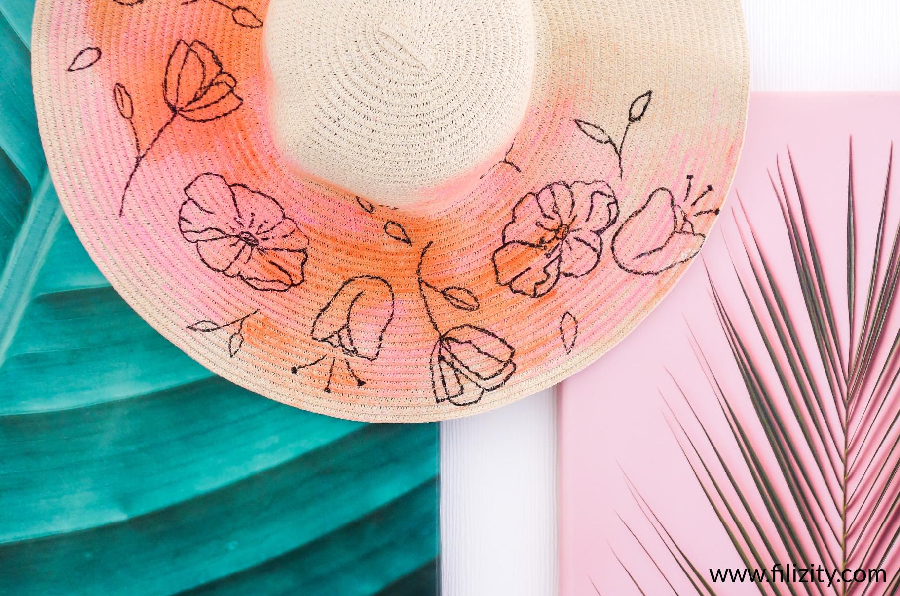 Sommer DIY: Sommerhut bemalen mit trendigen Line Art Blumen | Filizity. Kreativmagazin & DIY-Blog #sommerhut #aquarell #line-art